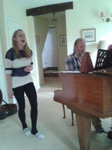 Rick Benbow, rehearsing with a singer